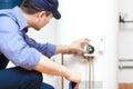 Plumber repairing an hot-water heater Royalty Free Stock Photo