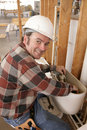 Plumber Repairs Toilet Royalty Free Stock Photo