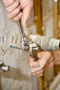 Plumber Tightens Valve Royalty Free Stock Images