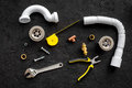 Plumber tools on black background top view