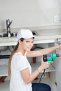 Plumber using the drill Royalty Free Stock Photo