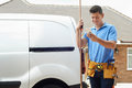 Plumber With Van Using Mobile Phone Outside House Royalty Free Stock Photo