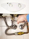 Plumber at work servicing gas boiler a Stock Images