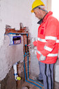 Plumber at work in a site Royalty Free Stock Photo