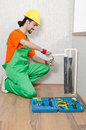 Plumber working in bathroom Royalty Free Stock Images