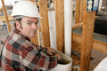 Plumber Working in Toilet Tank Stock Image
