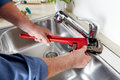 Plumber with a wrench. Royalty Free Stock Photo