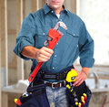 Plumber with wrench. Royalty Free Stock Photo