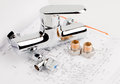 Plumbing and draft shower faucet tools lying on drafting for repair Royalty Free Stock Images