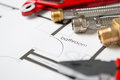 Plumbing Equipment On House Plans Royalty Free Stock Photo