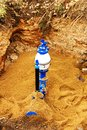 Plumbing and pipes water in the ground sand around the new pipe new in the ground Royalty Free Stock Photography