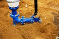 Plumbing and pipes water in the ground sand around the new pipe new in the ground Royalty Free Stock Photo