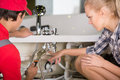 Plumbing professional plumber repair service woman is showing damage Stock Image