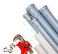 Plumbing supplies hard used red tool pipes and fittings on white background Stock Images
