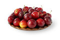 Plums on clay plate Stock Photography