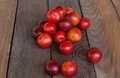 Plums fresh red on a wooden table Stock Image