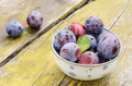 Plums on shabby wooden table Stock Photos