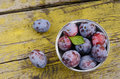 Plums on shabby wooden table Stock Images