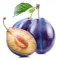 Plums with a slice and leaf Royalty Free Stock Photo