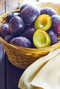 Plums in weaved basket Royalty Free Stock Photo
