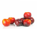 Plums on white seven fresh and crunchy victoria Royalty Free Stock Photo