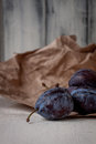 Plums on wrappers Royalty Free Stock Photo