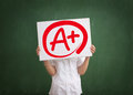 A plus grade education and school concept of elementary school student showing Royalty Free Stock Photo