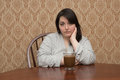 Plus size woman with a cup of coffee in a bathrobe looking sad Stock Photo