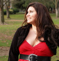 Plus-size woman in red dress Stock Image