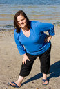 Plus Sized Fitness- Stretch on Beach Royalty Free Stock Images