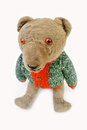 Plush teddy bear dressed in knitted sweater Royalty Free Stock Photography