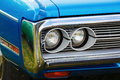 Plymouth fury minsk belarus may close up photo of the blue model year headlights of retro car iii selective focus Royalty Free Stock Photo