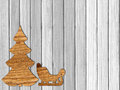 Plywood Christmas tree and sleigh on white wooden background Royalty Free Stock Photo