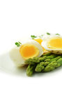 Poached egg and asparagus stylishly studio lit image of soft eggs with steamed stems against a bright background perfect for your Royalty Free Stock Photography