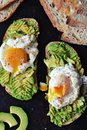 Poached egg and avocado toasts Royalty Free Stock Photo
