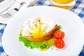 Poached egg with dill on bread tomato a side Stock Photo