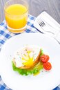 Poached egg with dill on bread tomato a side Stock Images