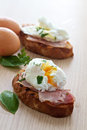 Poached egg and ham breakfast Stock Photos