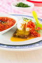 Poached egg on a toasted bread sliced breakfast with tomato sauce and dill Royalty Free Stock Photography