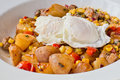 Poached eggs home fries with and corns Stock Images