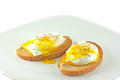 Poached eggs on rye toast fresh a white background Stock Photos