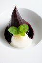 Poached pear and ice cream with red wine sauce Royalty Free Stock Photo