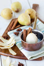 Poached pears pear prep with spices on a chopping board shallow dof Stock Photos