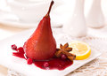 Poached pears in red wine with cinnamon Royalty Free Stock Photos