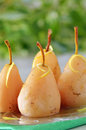 Poached pears in syrup Royalty Free Stock Photo