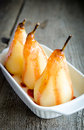 Poached pears in wine close up Royalty Free Stock Photos