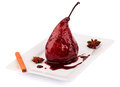 Poached pears in wine syrop with cinnamon isolated Royalty Free Stock Photo