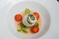 Poached sea bass and spinach roulade fillet of fennel tomato consomme Stock Photo