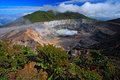 Poas volcano in Costa Rica. Volcano landscape from Costa Rica. Active volcano with blue sky with clouds. Hot lake in the crater Po