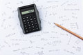 Pocket calculator, pencil and calculations Royalty Free Stock Photos
